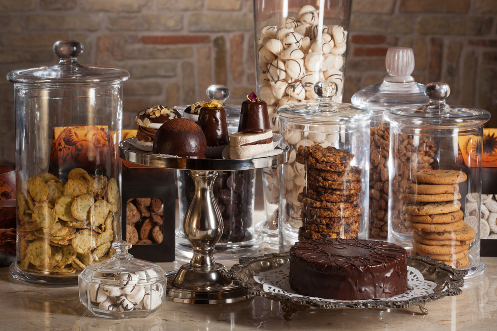 A chocolate buffet in glass jars, from cookies to candies to cakes.