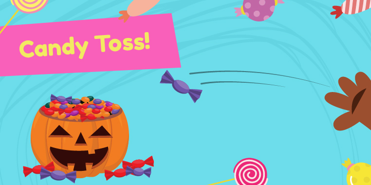 Purple candy being tossed into a candy-filled jack-o-lantern. 'Candy Toss' game for candy themed parties