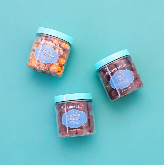 Candy Club jars filled with Caramel Popcorn, Chocolate Pretzels, and Bridge Mix