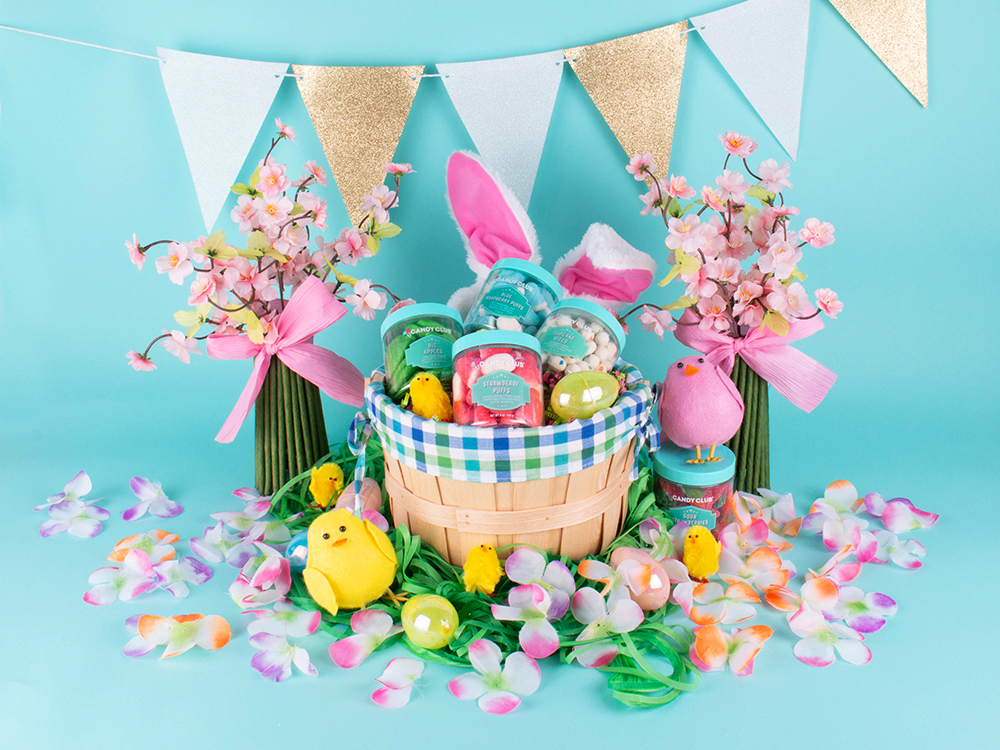 An Easter basket filled with Candy Club spring candies decorated with flowers