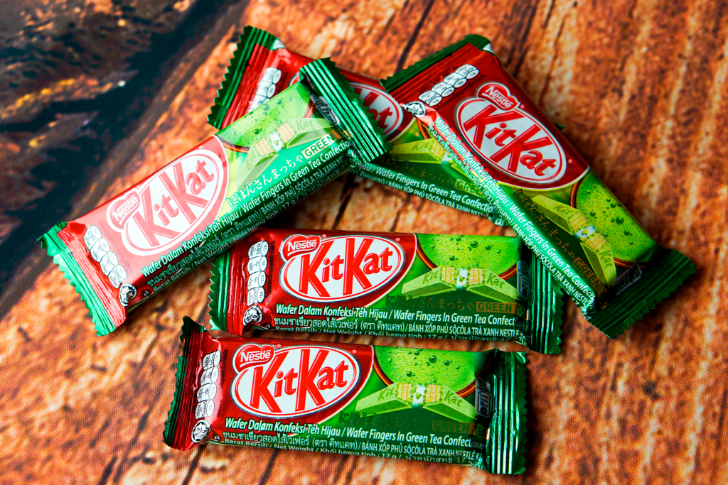 International Candy; Green Tea Kit Kats on a wooden background