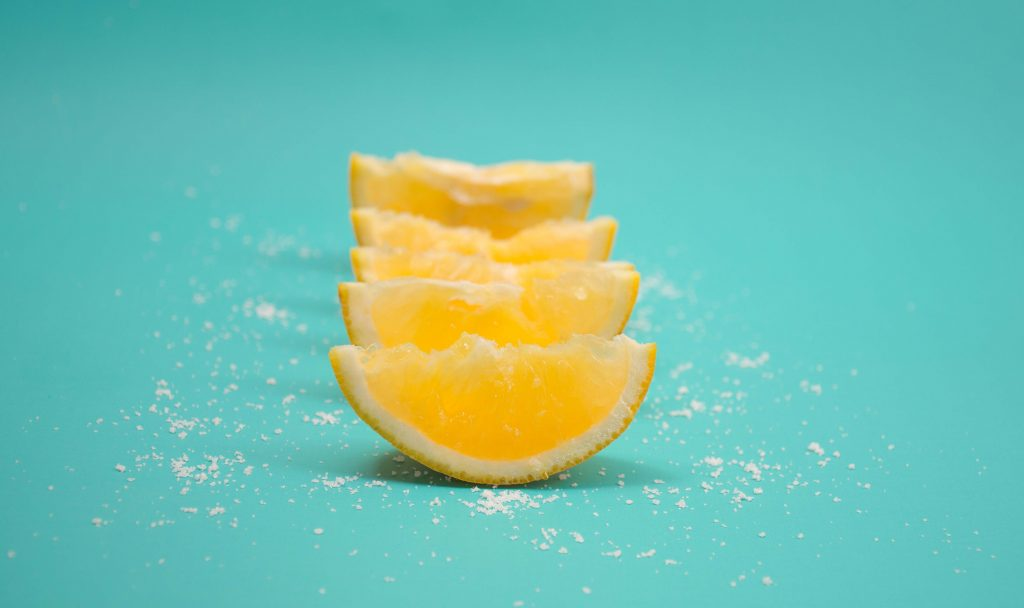 Sour Lemon slices on a teal background